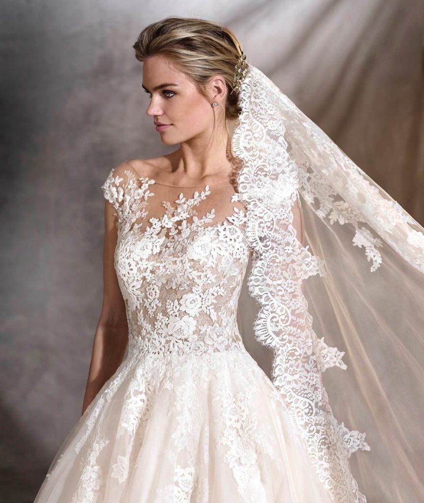 abito da sposa invernale velo a maniglia